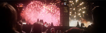 Thousands of people celebrating Canada on Parliament hill, watching fireworks